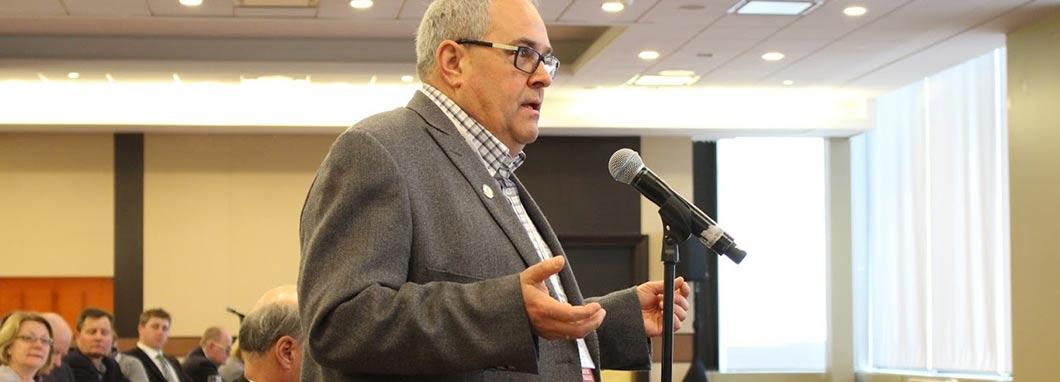 Member speaking at microphone