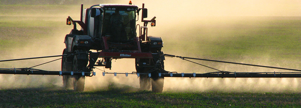 Tractor spraying a field. Photo by Flickr user Tamina Miller / CC BY-NC 2.0