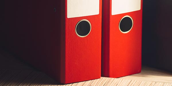 Red file folders on a table