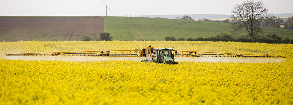 Tractor spraying a field. Photo by Chafer Machinery / CC BY 2.0